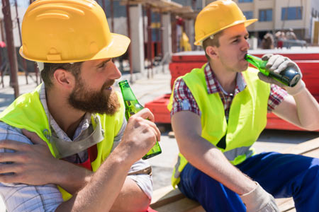 blue collar workers drinking alcohol